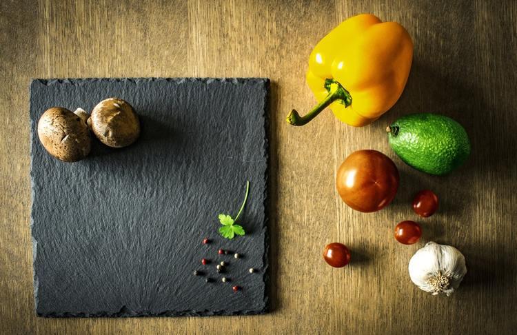 Cutting board with food
